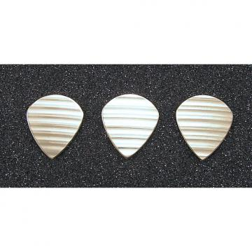 Custom Handmade 3 bronze guitar picks made from damaged cymbals. Jazz III style.